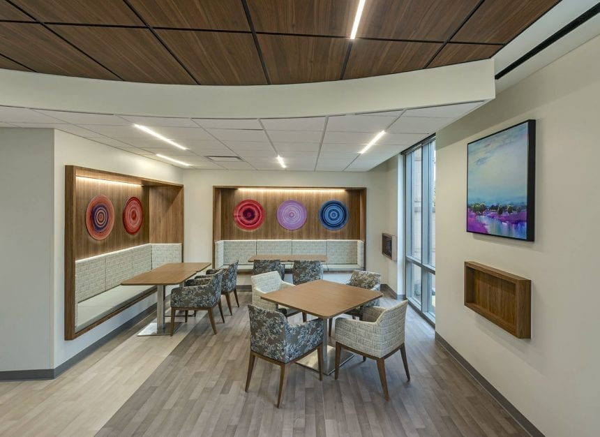 Houston Methodist Willowbrook - Dining Area. A round acrylic installation that enhances and brightens up the dining area at Houston Methodist. Photo credit: Jud Haggard Photography.