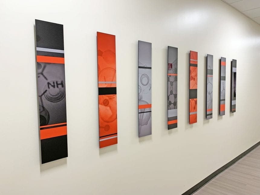 Acrylic totems at the Texas Tech Health Sciences Center, inspired by DNA sequencing
