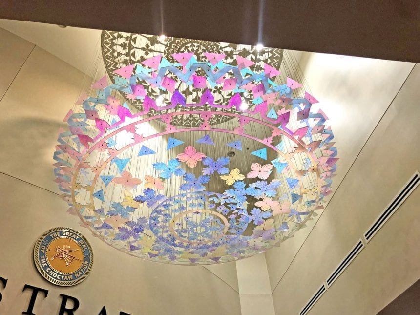 A colorful suspended sculpture is found in the lobby of Talihina Hospital in Choctaw Nation. Each piece is made up of dichroic filter in shapes of leaves and patterns that speak to the Native American culture.