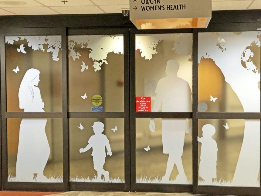 A window film depicting a Native American family