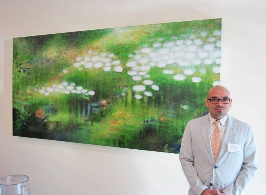 Henry Membreño with his acrylic work.