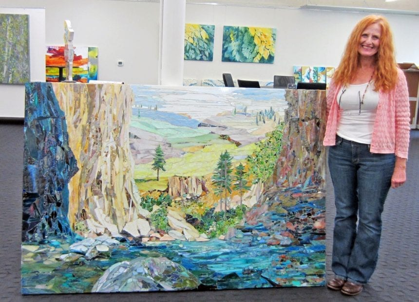 """Lauretta Newby-Coker with """"Milestone"""" - her elaborate mosaic art commissioned for Texas Health Frisco."""